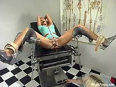 The spectacular blonde is getting toyed and teased with other kinky devices in this BDSM lesbian video courtesy of a nurse.