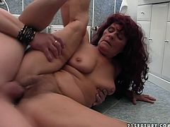 Chubby red haired slut hops on meaty dong like crazy. Her saggy boobs bounce and she moans with pleasure. Later he explores her pussy with fingers.