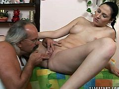 Filthy bitch is sucking hard dick of old country man. Then she lies on a table in the kitchen getting her fresh cherry polished well. Grandpa's mustaches tickle her pussy while he licks her twat. After, pretty girl is penetrated in her tight pussy hole missionary style.