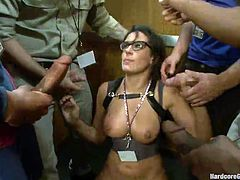 This hottie enters the elevator where all this guy silently admire her. She looks fucking hot and one of them can't help it anymore and grabs the bitch my her neck. Soon all of the dudes get wild with the brunette and she finds herself on her knees.