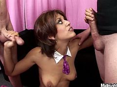 Short haired brunette Lyla Storm kneels down to suck two tasty dicks