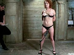 Redhead bitch Audrey Hollander is getting naughty with some guy in a basement. She lets him put her into chains and then enjoys various toys in her butt and coochie.