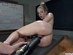 Slutty slim blonde Chastity Lynn is having fun with a sex machine indoors. She rubs her coochie with her fingers and then gets it slammed with a fucking machine.