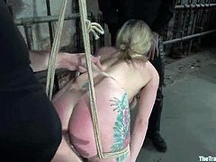 Slender and horny blond sex slave is being abused in a rough way. She gets chained and twitched on her hot and juicy melons.