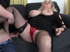 Busty whore Helena grabs her man's cock with passion and gives it a short, mean lick before putting it between her big breasts. She rubs his cock with those melons and then receives a deep pussy fingering as a prize. This mature whore needs and deserves a lot more than that and a big load of semen!