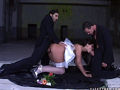 Dark-haired brunette temptress can't be satisfied by one dick only! She needs at least two stiff cocks to get maximum satisfaction. While one dude drills her wet twat in doggy position, appetizing babe with nice tits starts sucking the other dick passionately.