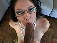 Sassy milf in glasses is licking and sucking a huge dick in POV