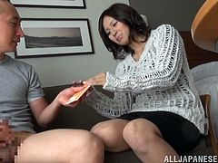While this dude plays with her panties and pussies, this Japanese girl is going to give him a nice handjob.