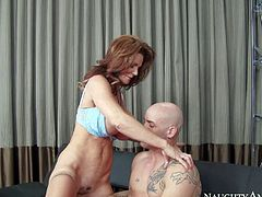 Cock hungry and busty cougar honey Deauxma gets down on her knees and gives Derrick Pierce a hot blowjob session in the living room in front of the camera and enjoys