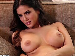 See the alluring brunette temptress Sunny Leone taking her black lingerie off and flaunting her hot ass and sexy tits. Then she's ready to rub her clam into ecstasy.
