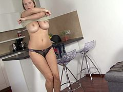 Busty blonde bitch gets naked & fingers herself in the kitchen