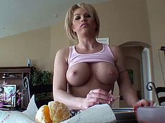Beautiful topless busty blonde Brooke Haven is eating fruits