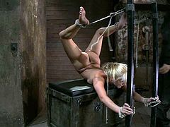 Amazing blonde girl in an amazing bondage video. She gets tied up in a weird pose and then the guy stuffs her pussy with a dildo.