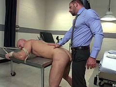 Mitch Vaughn is having fun with lewd gay Morgan Black in a hospital ward. Morgan plays with Mitch's amazing butt and then pounds it deep and hard from behind.