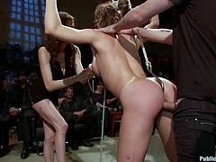 Salacious milf is having fun with a group of men in a basement. The dudes tie her up and enjoy the way she maons while they drill her tight holes.