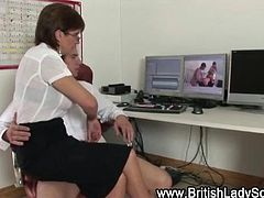 Stockinged mature office babe jerks off a cock