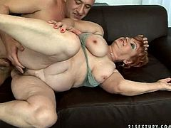 Voracious old granny with big saggy tits and fat ass is getting her muff pounded hard in a missionary and later in doggy sex positions.