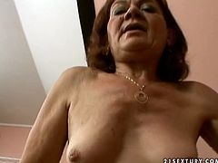 Shabby red-haired grandma shows off her slack body on cam before a kinky dude starts drilling her bearded puffy pussy in missionary style in pov sex scene by 21 Sextury.