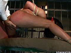 Damn, this girl is completely at the mercy of this horny dude. She is bound hand and foot for punishment in the prison cell. Spoiled harlot likes to be spanked hard because it makes her pussy get wet and makes the orgasm that much better.