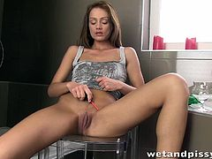 Sophie Lynx is in the bathroom and she pees into a cup. She sprays droplets of her urine onto her shirt with a dropper, before ripping her pee stained shirt off and exposing her perky tits. She masturbates while her pussy is dripping with piss.