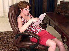Watch this horny lady spreading her legs wide open on a comfortable chair and playing with her clit just for you.