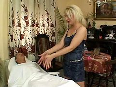 Sexy blonde wearing sexy black dress takes off her clothes and stands on her knees to give one dude eager blowjob. Watch sextractive blonde massaging dick for free.