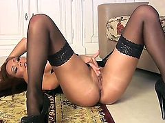 Adorable brunette babe Harley Kent with big round hooters and delicious ass in black lingerie and high heels spreads legs and polishes her honey pot to orgasm on the floor.