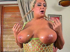 Lusty full figured blonde bitch Melodie with gigantic natural knockers and huge round ass in fishnet blouse sucks young Preston Parker with hot body and gives him great titjob.