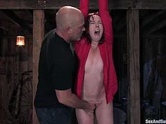 Delightful and charming redhead babe with a fine ass is getting tortured so hard! Babe loves the tightness of the ropes and the power of vibrators!