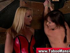 Dominant blonde spanks her slave with a paddle