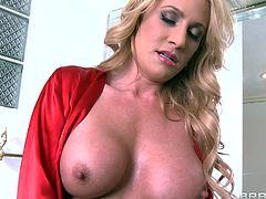 She is perfect with her big boobs, pretty face and long hair. The blonde goes in the bathroom where even she is turned on by her looks. The beauty begins to masturbate in front of the mirror but soon she receives a visit from Johnny that takes it from there. He plays with her boobs and kisses her, want some more?
