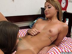 Lily shows some love to her much younger girl Marina. Marina is only 18 years old but already she discovered her lesbian lust. Lily lays her on her back, sucks her nipples and her sweet teen pussy. She then spreads her thighs, preparing to get licked by the teen cutie. Looks like the teen will learn a lot form her