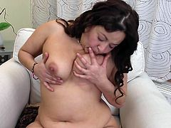 Andrea S pulls her fat saggy tis out of her bra and licks her nipples for you. She takes off the bra and licks her tits some more. she sticks her hand into her panties and masturbates herself. She likes you watching her finger herself.