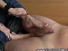Sexy femdom babe gives footjob to feet fetish bdsm guy