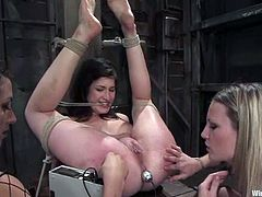 Stacey Stax gets bound by Harmony and Princess Donna Dolore in a cellar. The sluts play with Stacey's snatch and then fuck it deep and hard with a dildo.