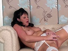 Elise Summers looks so hot wearing lingerie, watch this horny mature brunette playing with herself as she wears a very sexy outfit.