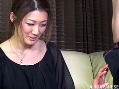 Hot Japanese woman is getting naughty with some dude indoors. She touches his prick shyly and then licks the prick and takes it deep into her mouth.