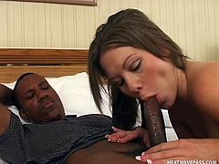 Brooklyn Night shows off her nice round belly to her black boyfriend then she gets to work on sucking his giant black member. She sucks his cock extremely well and blows him until he shoots his spunk on her.