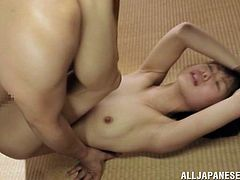Adorable Japanese girl gets undressed and fingered by two dudes. Later on she sucks their dicks and gets her hairy pussy fucked hard.