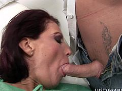 Lewd red-haired mature gives head to hard cock of her gynecologist