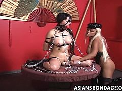 This Asian whore is put on display for her cruel masters to see. She is tortured mercilessly. She has a ball gag in her mouth so she can't yell for help and she's chained up. Her nipples are clamped for more pain. Watch as she gets a vibrator on her pussy and much more!