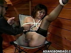 This Japanese slut is tied up in the attic by her master and her legs are spread open, so he can have easy access to her cunt. What can she do but try and ignore the pain. It's no use, because the pain is too much. She has clothespins clamped to her pussy lips and much more awaits her!