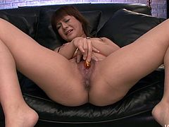 Nasty Asian bitch spreads her legs wide and expose her bushy pussy. She uses sex toy to satisfy her sex hunger. Watch Japanese solo girl right now. She is waiting for your meaty cock.