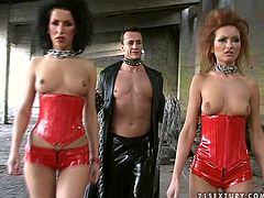 This is awesome cosplay video of horny stud in black leather outfit and two raunchy harlots in red corsets and high heel shoes. Girls are looking devilishly sexy and hot. The master chains two girls against one another and licks their pussies one after another.