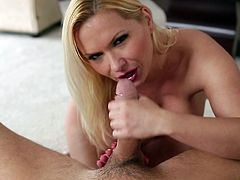 Curvy blonde mom Katja Kassin is getting naughty with some dude. She strips and shows him her big natural tits and allows him to finger her snatch. Then she gives him a terrific blowjob.