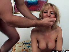 Lustful cougar is greedily sucking hard dick of horny dude. She plays with cream in her mouth when he cums. Then he pisses on her pussy.