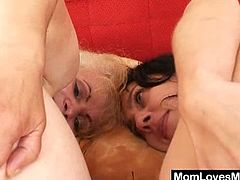 The old blonde mom licks pussy and puts a black vibrator inside before she takes another vibrator and puts it in her old cunt.