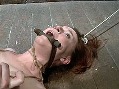Her man is such a maniac and asshole, who tortures her in the most refined ways. Babe gets gagged with piece of wooden stick so that she would bite it when she feels sore!