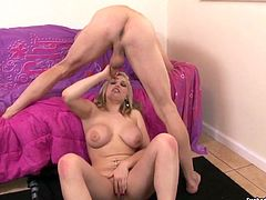 Hawt blonde having jaw dropping big boobs gives hand job to one horny stud. She jerks off his dick in 69 position with only one desire to get cum load.