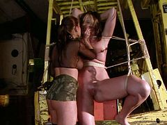 Spoiled nympo with big tits is securely tied to a frame by sexy mistress. Wicked dominatrix finger her juicy muff and then she stretches her snatch with a huge dildo. Make sure you don't miss this wild BDSM sex scene!